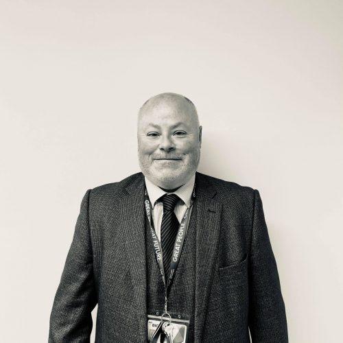 Jonathan Mallon an employee of Mount Charles Group smiling
